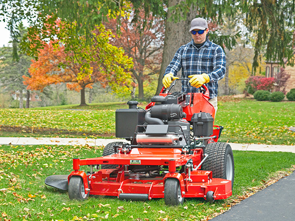 Man riding 360z xt zero turn mower in front of house