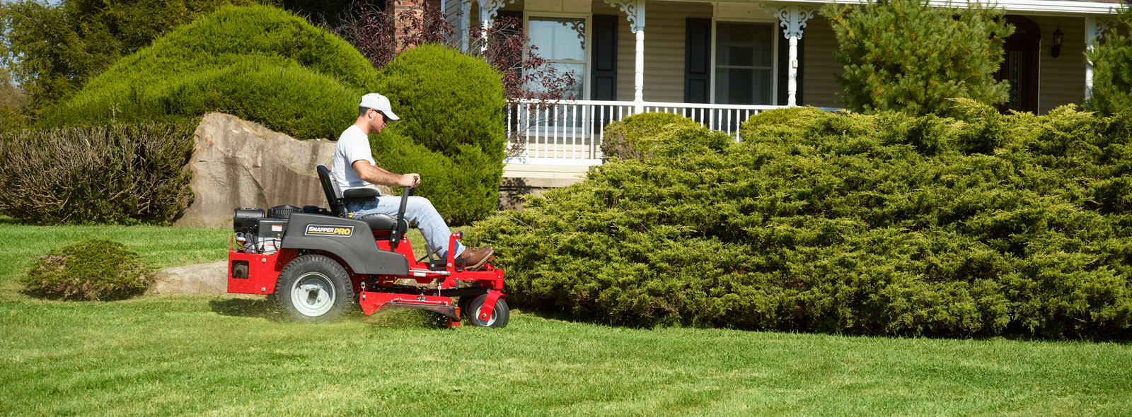 Man cutting grass with Snapper Pro zero turn mower
